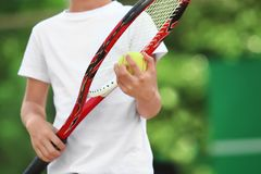 Cute little boy playing tennis. On court Stock Image