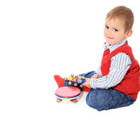 Cute little boy playing with toys Stock Photo
