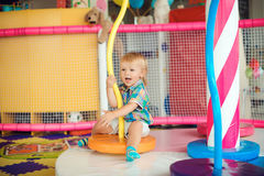 Cute little boy playing with toys on playground in kindergarten. Stock Photography