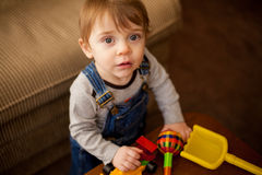 Cute little boy playing with toys Royalty Free Stock Photo