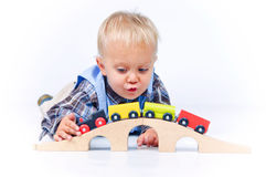 Cute little boy playing trains Royalty Free Stock Photography