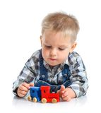 Cute little boy playing trains Royalty Free Stock Photo