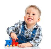 Cute little boy playing trains Stock Images