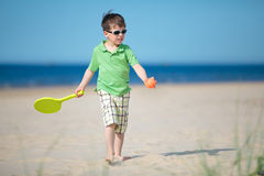 Cute little boy playing on tropical beach Stock Images