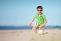 Cute little boy playing on tropical beach Stock Image