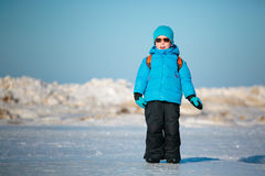 Cute little boy playing on winter beach Royalty Free Stock Images