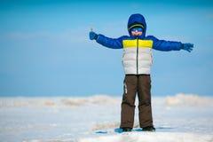 Cute little boy playing on winter beach Stock Image