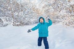 Cute little boy plays in winter park. A cute little boy plays in winter park Royalty Free Stock Images