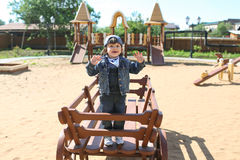 Cute little boy plays on wooden playpit Stock Photography