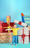 Cute little boy with plenty of gifts Stock Photos