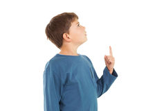 Cute little boy pointing up Stock Photos