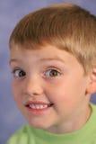 Cute little boy portrait on bl. Shot of a cute little boy portrait on blue vertical Royalty Free Stock Photography