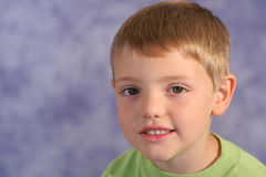 Cute little boy portrait on bl Stock Photos