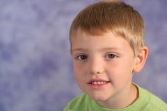 Cute little boy portrait on bl. Shot of a cute little boy portrait on blue Stock Photos