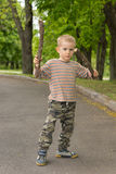 Cute little boy practising stick fighting Stock Photo