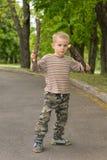 Cute little boy practising stick fighting Stock Photo