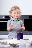 Cute little boy preparing muffins Royalty Free Stock Photo