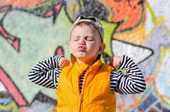 Cute little boy pulling a face Royalty Free Stock Photos