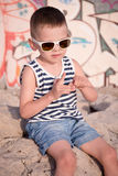 Cute little boy pulls out a splinter from his finger Royalty Free Stock Images