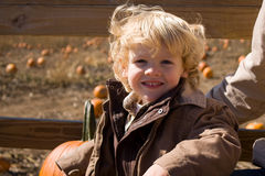 Cute little boy at the pumpkin patch. Cute little boy on a hayrack ride at the pumpkin patch Royalty Free Stock Image
