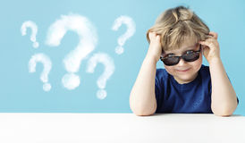 Cute little boy with queries Stock Photo