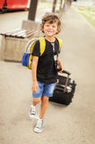 Cute little boy on a railway station Stock Images