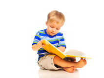 Cute little boy is reading a book Stock Photo