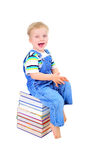 Cute little boy is reading a book Stock Photos