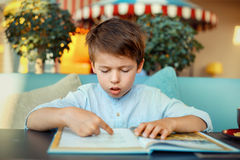 Cute little boy reading book Royalty Free Stock Image