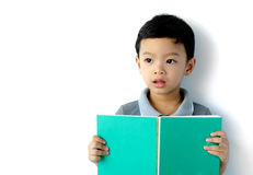 Cute little boy reading a book Stock Image