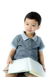 Cute little boy reading a book Royalty Free Stock Images