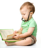 Cute little boy reads a book Royalty Free Stock Images