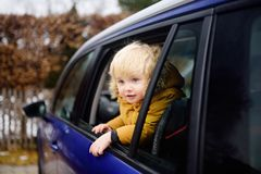 Cute little boy ready for a roadtrip or travel. Family car travel with kids. Child transportation safety Royalty Free Stock Photo