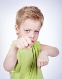 Fight. Cute little boy ready to fight someone Royalty Free Stock Image