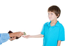 Cute little boy receiving money Stock Images