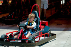 Cute little boy on red go cart. Royalty Free Stock Photography