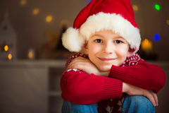 Cute little boy in red hat waiting Santa Claus Royalty Free Stock Photo