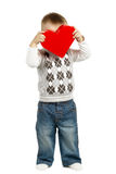 Cute little boy with red heart Stock Images