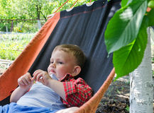 Cute little boy relaxing in a hammock Royalty Free Stock Photography