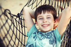 Cute little boy relaxing in a hammock Stock Image
