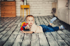 Cute little boy resting. On the floor in the studio Royalty Free Stock Image
