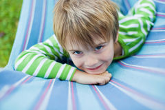 Cute little boy resting in hammock Royalty Free Stock Photography