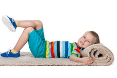 Cute little boy rests on the carpet Royalty Free Stock Images