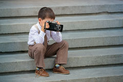Cute little boy with retro camera outdoors Stock Photo