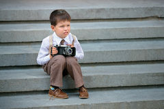 Cute little boy with retro camera outdoors Royalty Free Stock Image