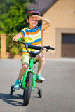 Cute little boy riding bicycle Stock Photo