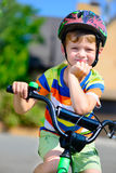 Cute little boy riding bicycle Stock Photography