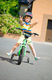 Cute little boy riding bicycle Stock Photos