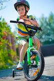 Cute little boy riding bicycle Royalty Free Stock Photo