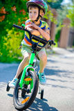 Cute little boy riding bicycle Royalty Free Stock Photography